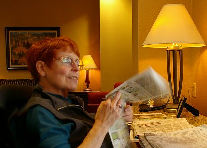 Peg relaxing and enjoying the reading room at the Marriott Courtyard Tacoma in Tacoma, Washington - image.