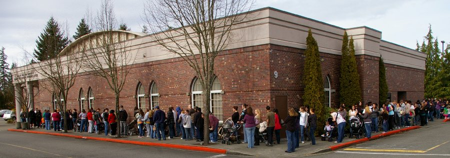 The line to enter Operation Baby Shower stretched around the block and beyond in Lacey Washington - photo.