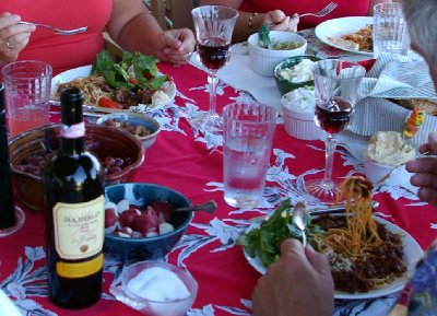Joining the dark red Bimbo Sauce was a maple-fig dressed salad, bread, tapenade, dips, butter whipped with olive oil, and wine.