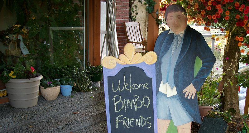A plywood cutout of Don welcomes guests.