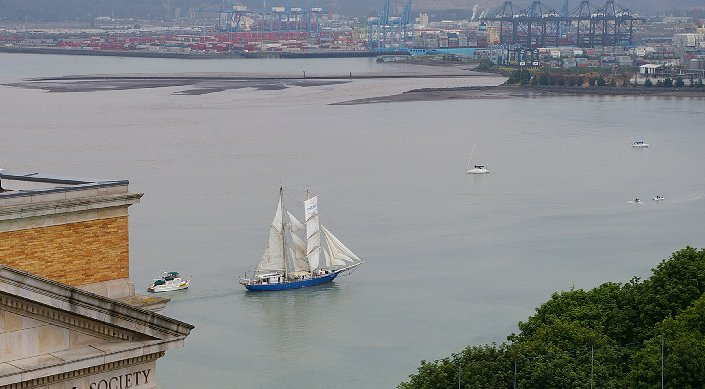 A Tall Ship sailing by the old Historical Museum and into the Thea Foss.