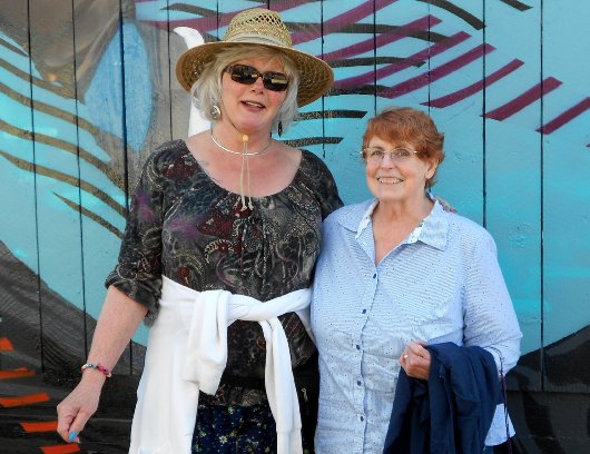 Rita Morkrid and Peggy Doman standing in the alley outside the Crown Bar on Sixth Avenue in Tacoma - image.
