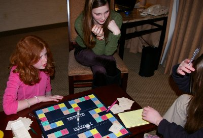 Bailee, Caitlin, and Daron playing Pictionary - photo.