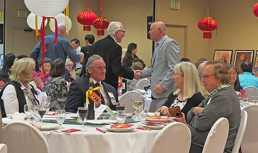 Friends Ron Lunceford and Mike Dunlap greeted each other at the Chinese Reconciliation Foundation Project Dinner in Tacoma - image.