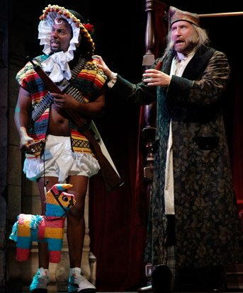 Reginald Andre Jackson with his Mexican Christmas pinata and Ian Bell in Inspecting Carol at Seattle Rep. Photo by Chris Bennion.
