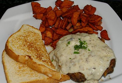 Chicken fried steak served at Dirty Oscar's Annex on 6th Avenue in Tacoma, Washington.