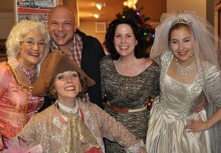 Rosalie Hilburn as the Fairy Godmother, Hilary Hinz as Prince Charming and Erin Herrick as Cinderella with two fans at the CenterStage in Federal Way.