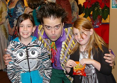 Grandchildren enjoying meeting Erik Gratton as Buttons in Cinderella at CenterStage in Federal Way.