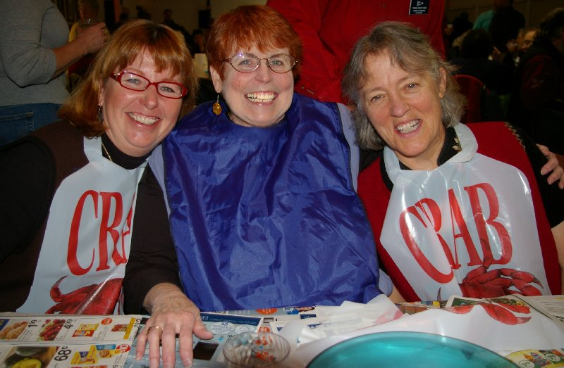 Debbie Irwin, Peg Doman and Jan Runbeck enjoying themselves at the Totem Yacht Club crab feed fundraiser - photo.