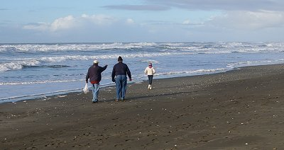 Donn, Rob, and Vickie walking on the beach - Ocean Shores Washington Adventure.