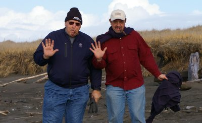 Rob and Donn on the beach with cigars - Ocean Shores Washington Adventure.