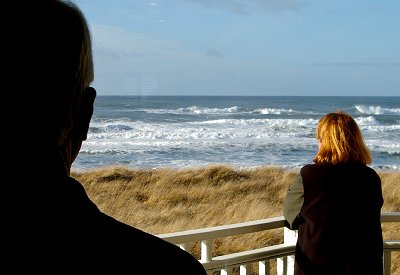 Mike Mowat and Debbie Irwin watching the waves - Ocean Shores Washington Adventure.
