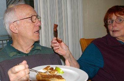 Peg feeding Mike pepper bacon - Ocean Shores Washington Adventure.