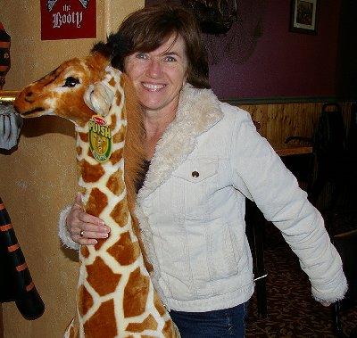 Vickie riding a giraffe - Ocean Shores Washington Adventure.