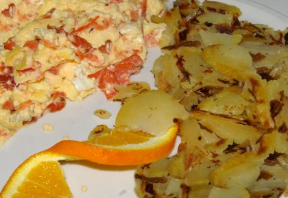 Scrambled eggs with salmon and breakfast potatoes from the Chanterelle Restaurant in Edmonds, Washington - image.