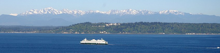 A view of the Kingston Ferry and the Olympic Mountains from Edmonds, Washington.