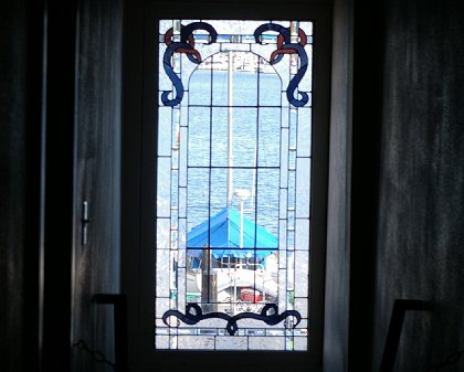 The stained glass window from inside the MarketPlace Grille in Gig Harbor, Washington - image.
