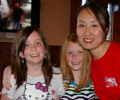 Two grandchildren at The Honey Pig Korean BBQ Tacoma, Washington.