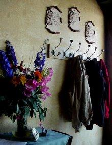Simple coat hooks and flowers.