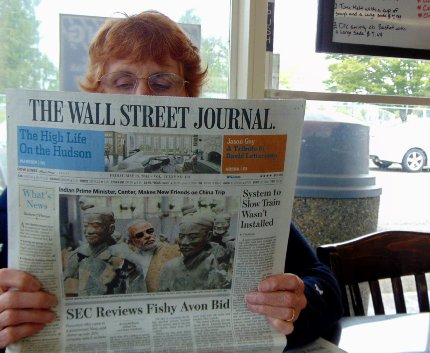 Peg Doman reading the Wall Street Journal at Don's Drive-In in Puyallup, Washington.