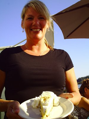 The waitress Sandy serving homemade key lime pie at the Waterfront Cafe in La Conner, Washington - Photo.