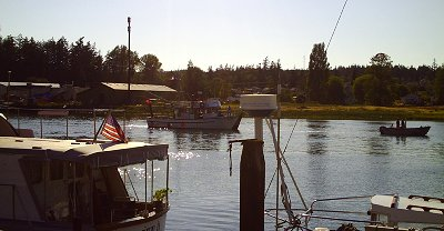Boat traffic on the channel in downtown La Conner, Washington - Photo.