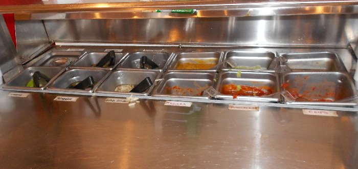 The condiment station at Los Tamales Restaurant Tacoma - image.