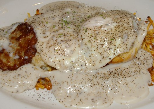 Hash browns, sausage, biscuit, fried eggs, and gravy in Tacoma - image.
