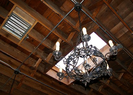 Hanging light fixture right below a skylight at the Manhattan Steakhouse in Seattle - image.