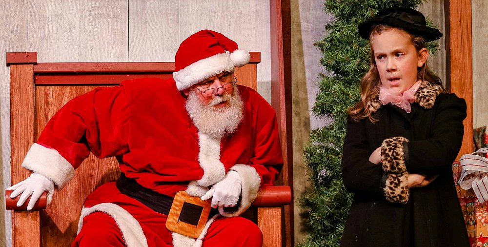 Kris Kringle played by Michael Dresdner and Susan played by Abbie Wachter at Tacoma Little Theatre - Photo courtesy Dennis K Photography - image.