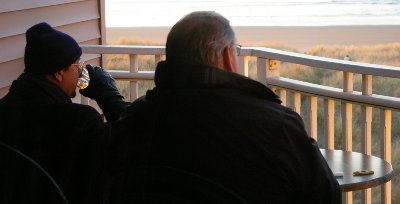Donn and Rob enjoy cigars and cold Scotch as they watch the waves at Ocean Shores.