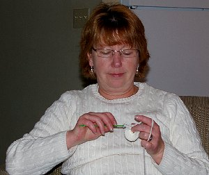 Debbie knitting in Ocean Shores.
