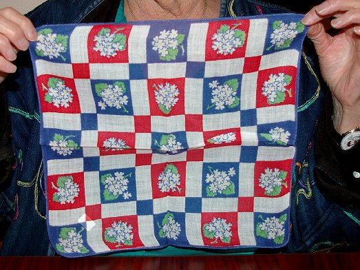 Peggy Doman showing off a new hanky for her collection while in Ocean Shores - image.