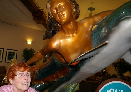 A mermaid and dolphin statue in the lobby of the Shilo Inn at Ocean Shores, Washington - image.