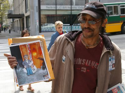 Calvin Turner selling Changing Times on the corner in Seattle outside the Dahlia Lounge.