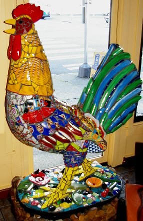 A giant mosaic rooster gruards an emergency exit at the Palace Chicken . . . oops, Kitchen.