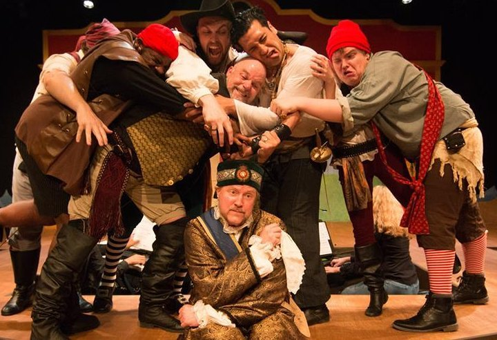 The pirate crew and Major General Stanley (Gary Chambers) in The Pirates of Penzance at Lakewood Playhouse - PHOTO by TIM JOHNSTON - image.