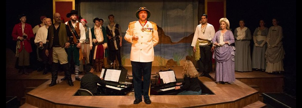 The Lakewood Playhouse company of The Pirates of Penzance featuring Gary Chambers as the Major General - PHOTO by TIM JOHNSTON - image.