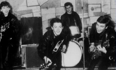 A photograph of the early Beatles featuring George Harrison, Paul McCartney, John Lennon and Pete Best - Photo.