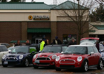 A Mini-Cooper gathering in the rain at a parking lot in Tacoma, Washington - Photo.