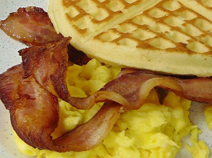 Bacon and eggs with waffle at Papa Eddies Cajun Cafe on South Tacoma Way.