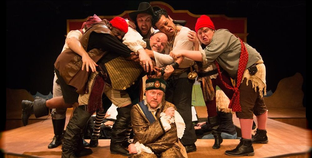 Most of the pirate crew and Gary Chambers as the Major General from the Lakewood Playhouse Production of The Pirates of Penzance - PHOTO by TIM JOHNSTON - image.
