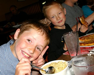 Riley and Jake enjoying their dinner from Mama Stortini's restaurant in Puyallup, Washington.