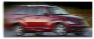PT Cruiser in motion.