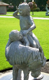 A Shetland and  children statue at Pioneer Park in downtown Puyuallup.