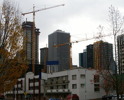 Construction cranes in downtown Seattle - image.