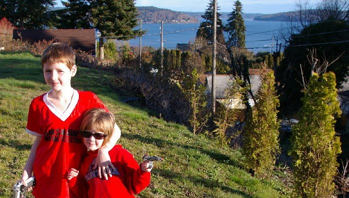 Two of our little Red Rangers and the view of Vashon Island from our backyard in Tacoma, Washington - Photo.
