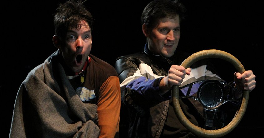 Enzo and Denny speeding in The Art of Racing in the Rain at Book-It Theatre in Seattle, Washington. Photo by Alan Alabastro.
