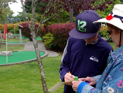 Adding up scores for miniature golf at Tacoma Firs Golf Center - image.