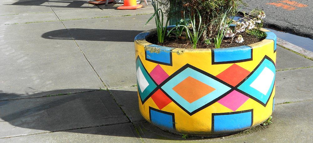 Colorful planters are on MLK just outside the Red Elm Cafe in Tacoma - image.